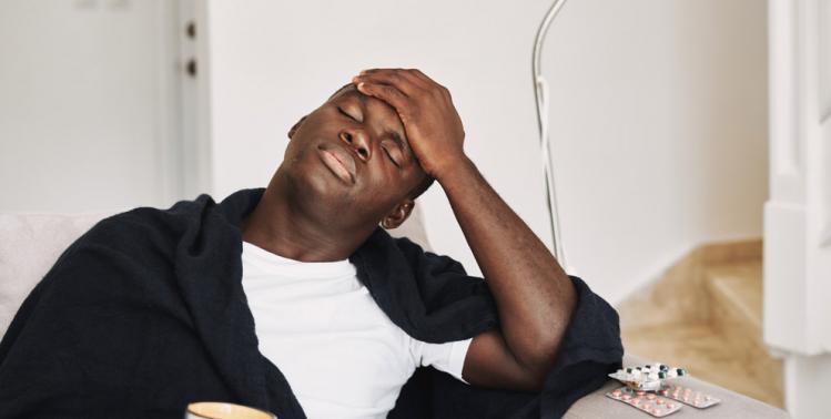 Racial Health Disparities - African American Male sick with flu